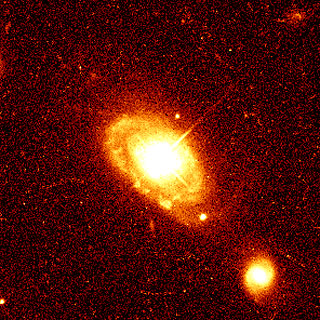 Quasar & Host Galaxy [NASA-ESA Hubble]