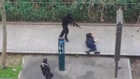 Islamists Assassinating Wounded Cop in Paris 1/7/2015.