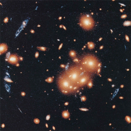 Galactic Cluster Focuses Blue Galaxy Light