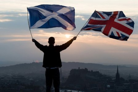 The Sun Is Setting On The (Extreme) Right Flag. Edinburgh Castle Below.