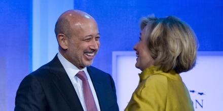 There Are Countless Pictures Of Hillary Clinton Apparently In Love With The Chair Of Goldman-Sachs (Left)