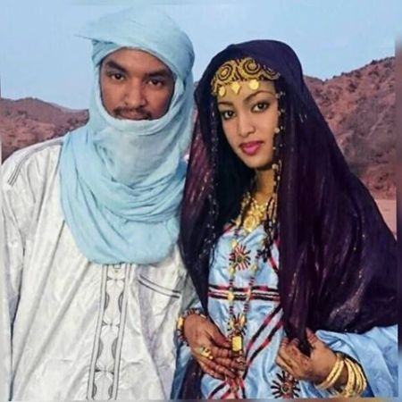 A Touareg Couple. The Blue People of the Desert. Don't Call Them Black: They Would Think You Are A Lunatic, Ignorant, Offensive, Vicious Aggressor. And they are not Arabs, either... Touareg alphabet is more than twice older than Arabic alphabet...